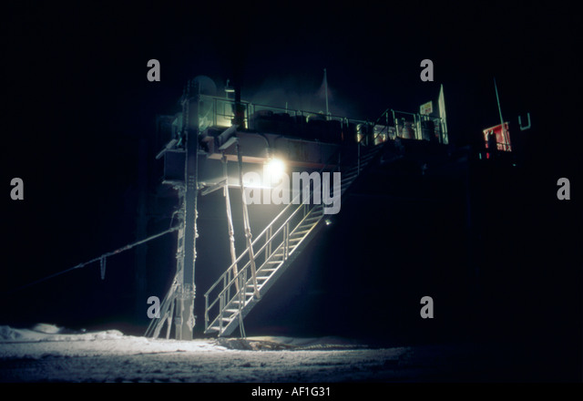 The starkly-lit steps of the Laws Building in midwinter, Halley Bay, Antarctica - Stock Image