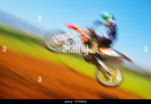 Blurred image of biker on championship, active lifestyle, extreme sport, slow motion, motocross on off-road, speed - Stock Image