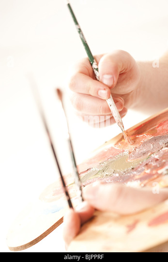 Paint palette and brushes - Stock Image