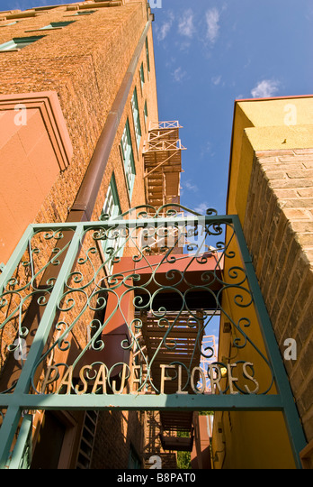 San Antonio alleyway with fire escapes cityscape cast iron doorway texas tx city skyline - Stock Image