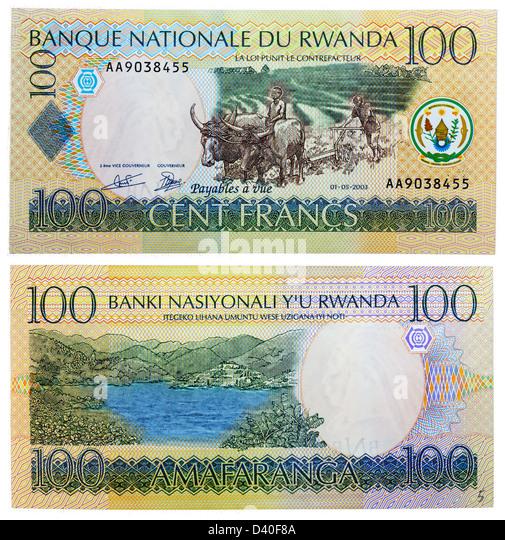 100 Francs banknote, farmer plowing, mountain and lake, Rwanda, 2003 - Stock Image