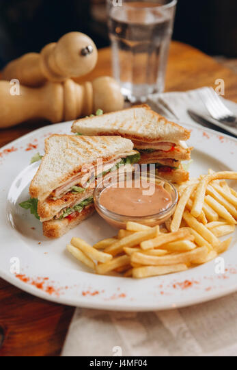 Sandwich with french fries on plate - Stock-Bilder