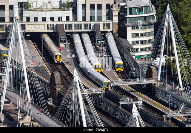 Trains at Charing Cross station showing commuters - Stock Image