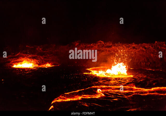 Lava bubbles burst on the surface of the Erta Ale lava lake, Ethiopia - Stock Image