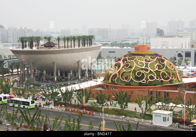 Saudi Arabia Pavilion with Date Palm Trees planted on top. India Pavilion next. - Stock Image
