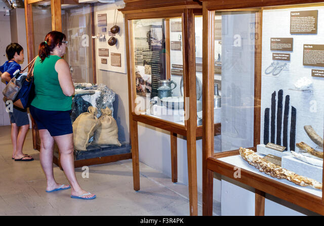 Florida Key West Keys Mel Fisher Maritime Museum inside exhibits Asian boy woman looking - Stock Image