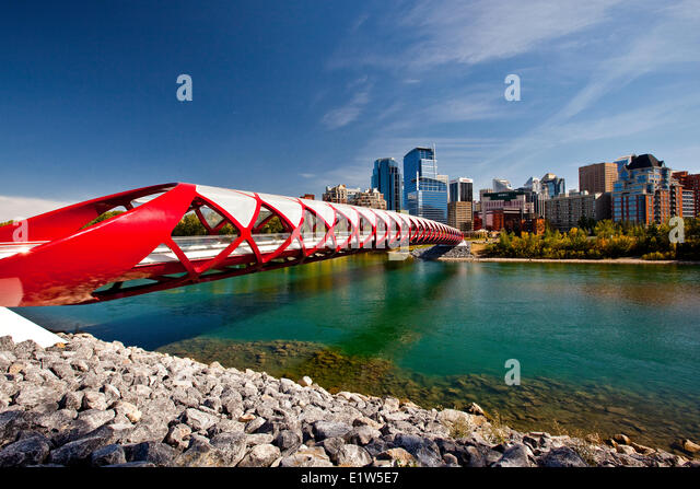 Calgary Peace Bridge downtown highrise buildings (Peace Bridge is a pedestrian bridge designed by renowned Spanish - Stock Image