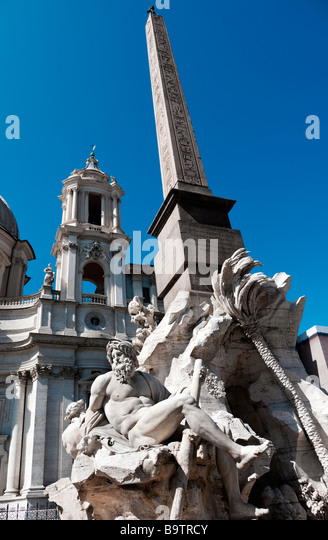 Fountain of the Four Rivers and Egyptian obelisk in Piazza Navona, Rome - Stock Image