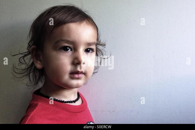 Portrait of two year old boy - Stock Image