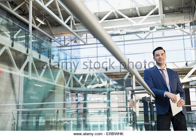 Portrait of confident businessman in atrium - Stock-Bilder