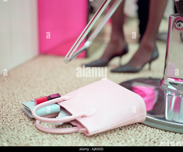 Handbag on beauty salon floor - Stock Image