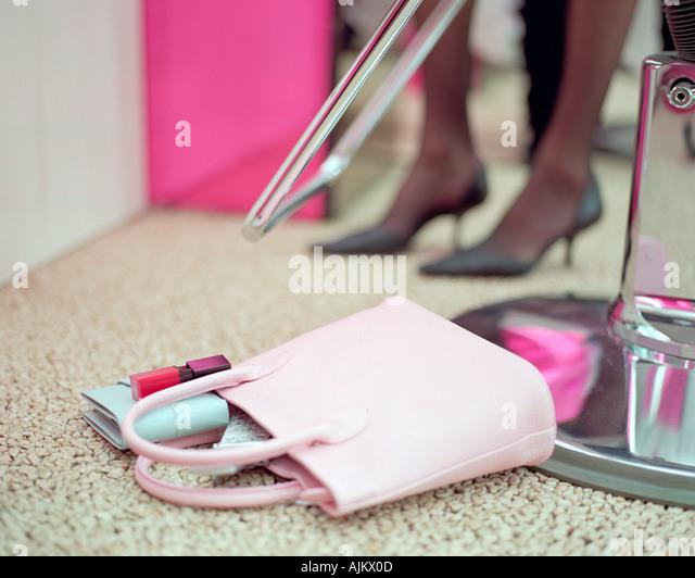 Handbag on beauty salon floor - Stock Image