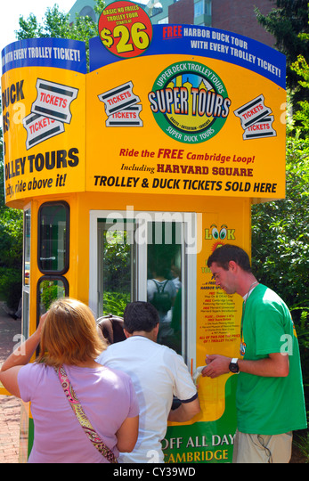 Massachusetts Boston Cambridge Upper Deck Trolley Tours guide attendant woman customer booth ticket vendor - Stock Image