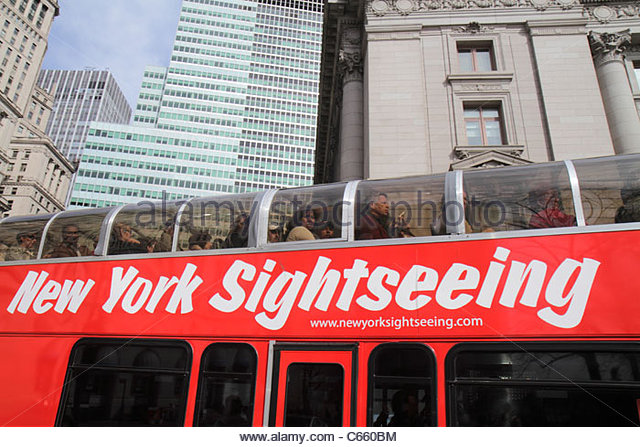 New York New York City NYC Lower Manhattan Financial District FiDi building double-decker bus guided tour passenger - Stock Image