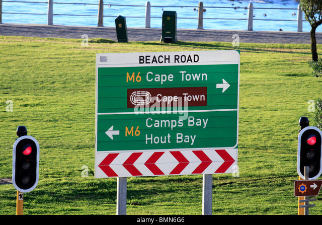 Sign in Sea Point at the promenade with directions to Cape Town, Camps Bay and Hout Bay. - Stock Image
