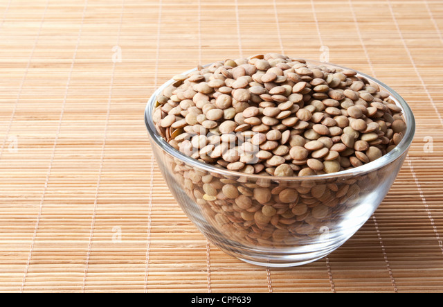 glass bowl full of laird lentils - Stock Image