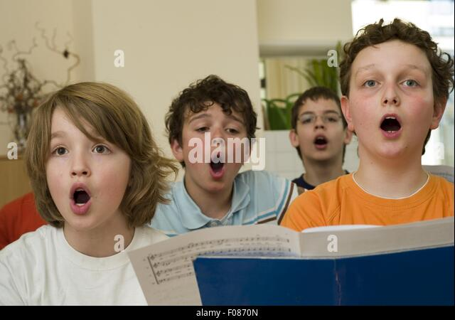 young boy singing in church