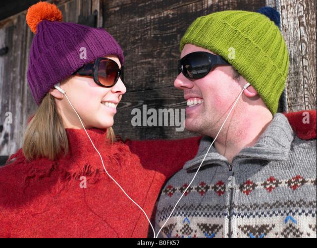 Couple listening to music at chalet - Stock-Bilder