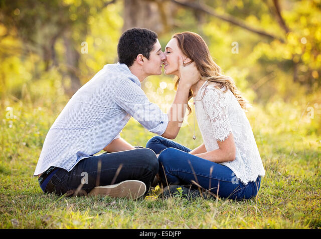 a young couple about to kiss - Stock Image