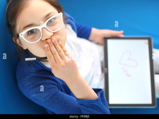 First love, girl draws a heart. I love you .... Child playing with tablet - Stock-Bilder