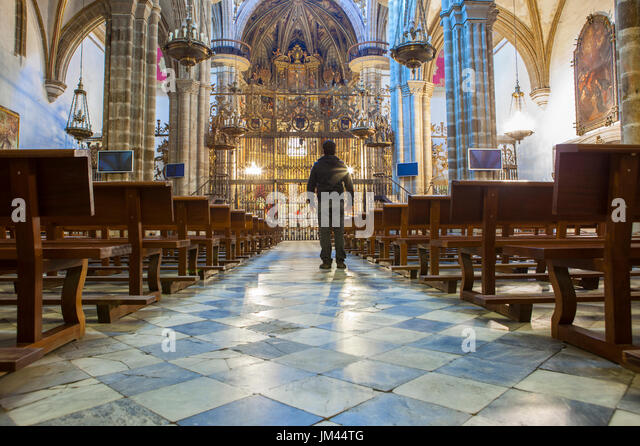 Tourist observing the Virgin of Guadalupe Monastery Basilica, Caceres, Spain - Stock Image