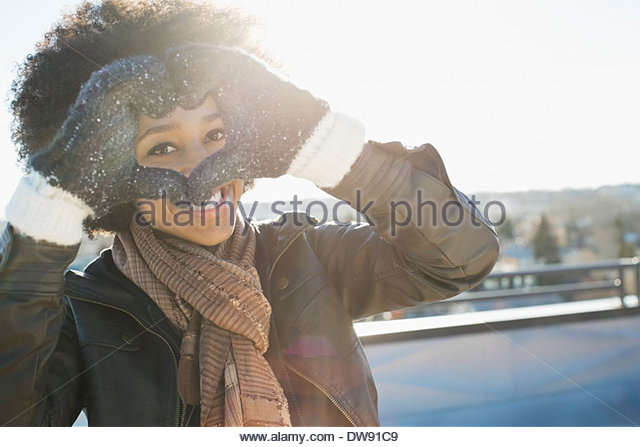 Woman forming heart with hands - Stock Image