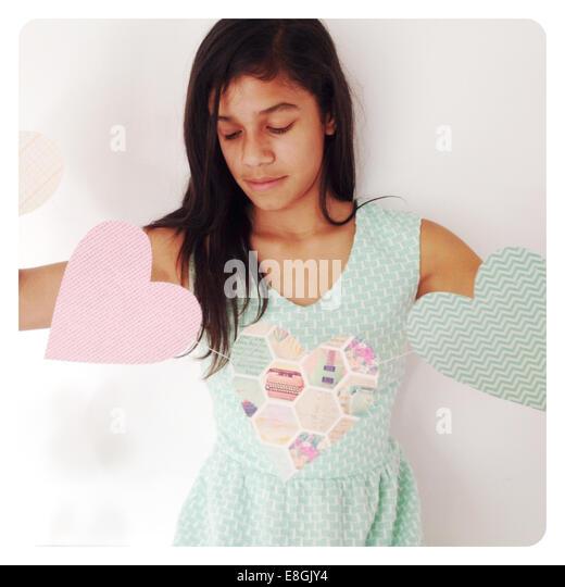 Girl holding heart shape banner - Stock Image