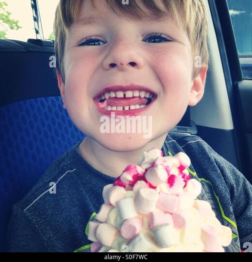 Boy eating a marshmallow ice-cream - Stock Image