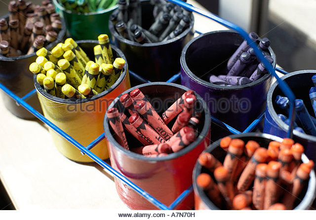 Pots of multi coloured crayons in rows close up still life - Stock Image