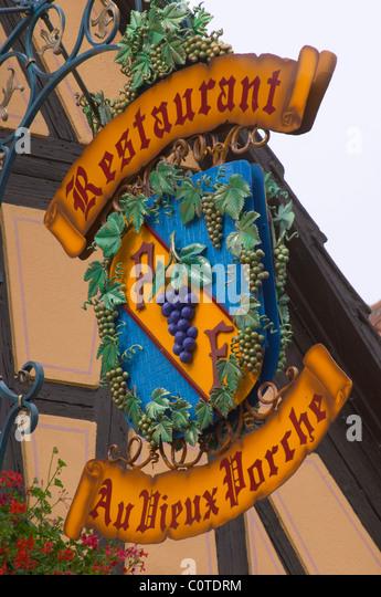 wrought iron sign restaurant au vieux porche dom paul zinck eguisheim alsace france - Stock Image