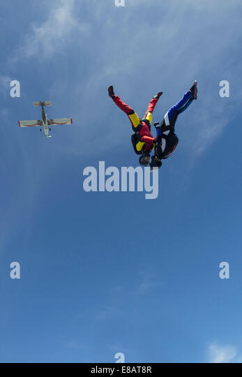 Team of two female skydivers in head down position over Buttwil, Luzern, Switzerland - Stock-Bilder