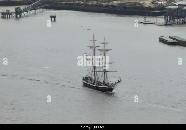 London, United Kingdom - April​ ​12: A vessel sails around the O2 Arena on the river Thames ahead of the Tall Ships - Stock Image