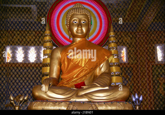 Golden statue of  Buddha (Buddah) in Wat Krom. Sihanoukville, Cambodia - Stock Image
