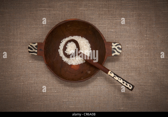 Wood bowl with rice and spoon - Stock Image