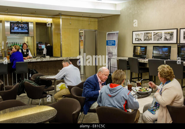 New York New York John F. Kennedy International Airport JFK terminal concourse gate area American Airlines Ambassador - Stock Image