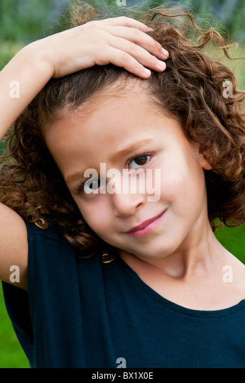 Beautiful girl hand over hair smiling Beirut Lebanon Middle East - Stock Image