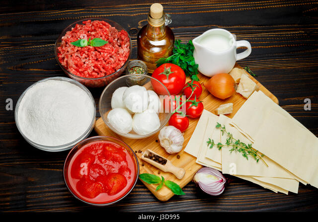 lasagna ingridients on wooden table - Stock Image