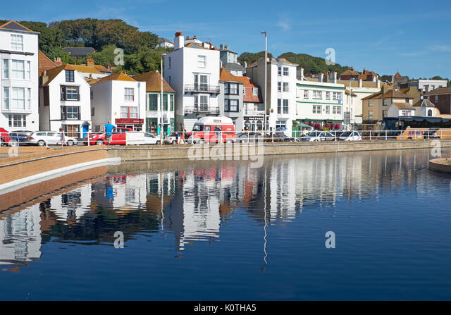 Hastings seafront promenade and houses reflected in the boating lake, East Sussex, UK, GB - Stock Image