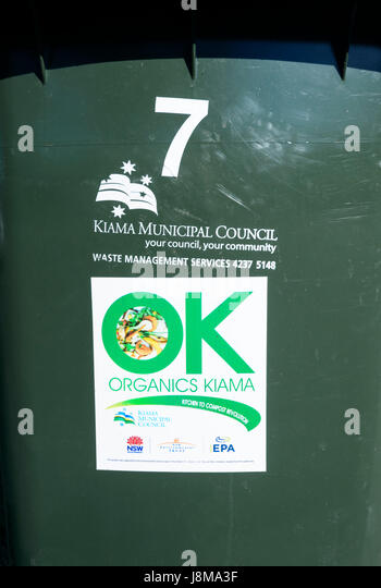 Recycling sign on a bin for compost from organic items, Kiama, New South Wales, NSW, Australia - Stock Image