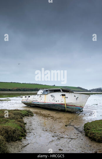 remains boat abandoned beached Gannel Estuary gloomy overcast day Newquay Cornwall UK weather - Stock Image