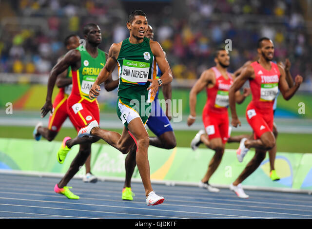 RIO DE JANEIRO, BRAZIL - AUGUST 14: Wayde van Niekerk of South Africa wins the mens 400m final and sets a new world - Stock-Bilder