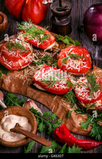 Eggplant and tomato stacks rustic - Stock Image