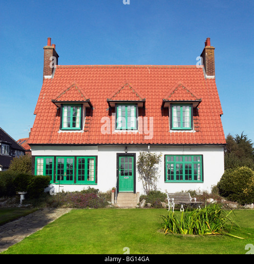 1920's detached house and front garden. Thorpeness, Suffolk, UK - Stock Image