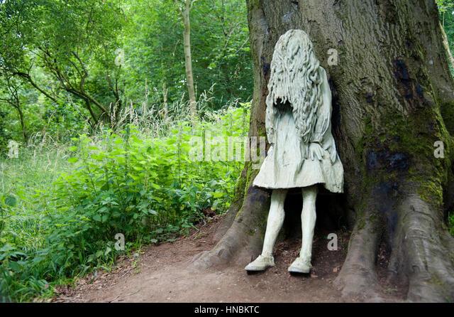 Weeping girl statue at Jupiter Artland, Edinburgh. - Stock Image