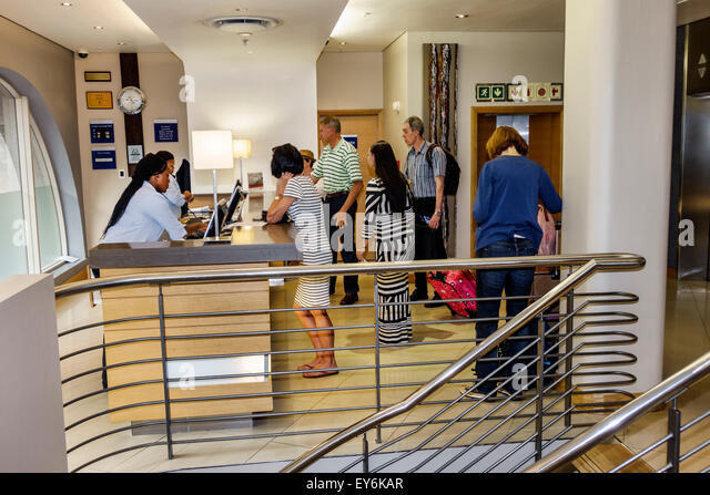 Cape Town South Africa African Holiday Inn Express City Centre center hotel inside interior lobby front desk reception - Stock Image