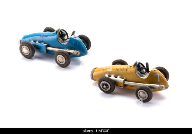 Two vintage style model toy racing cars in blue and yellow - Stock Image