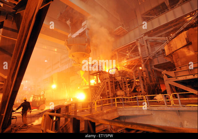 Process of pouring of molten iron inside steel plant ; Essar steel ; Hajira Plant ; Surat ; Gujarat ; India - Stock Image