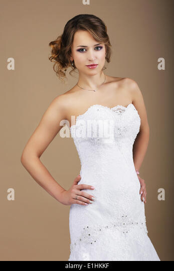 Lovely Woman wearing White Bridal Dress - Stock Image