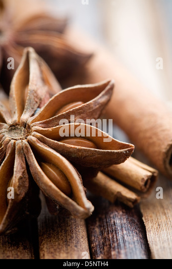 Star anis on brown background, shallow focus - Stock Image