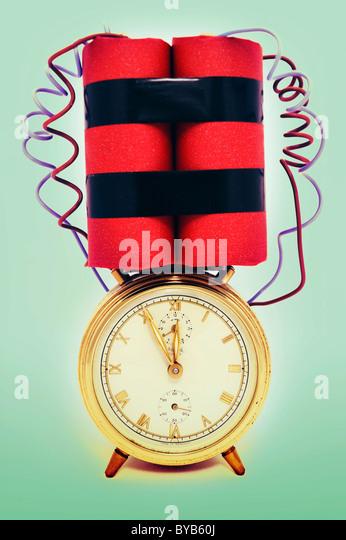 Time bomb, alarm clock with explosive device, symbolic image - Stock Image